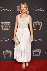 Sienna Miller kept it relaxed yet chic in a white maxi dress by Valentino during the Cartier Fifth Avenue grand reopening.