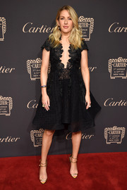 Ellie Goulding polished off her sophisticated look with strappy gold sandals.