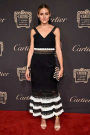 Olivia Palermo was boho-chic in a black-and-white macrame crop-top by Jonathan Simkhai at the Cartier Fifth Avenue grand reopening.