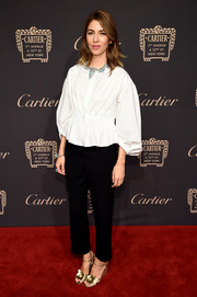 Sofia Coppola sealed off her look with flower-adorned gold wedges.