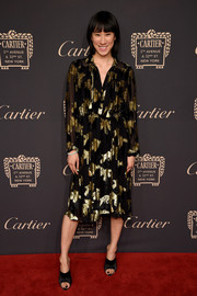 Eva Chen looked effortlessly chic in a black and gold midi dress by Adam Lippes at the Cartier Fifth Avenue grand reopening.