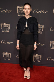 Rooney Mara finished off her signature all-black look with a pair of ankle-strap heels.