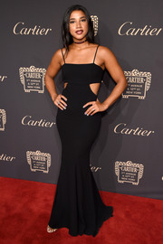 Hannah Bronfman heated up the red carpet with this slinky black cutout gown by Zac Posen at the Cartier Fifth Avenue grand reopening.