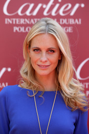 Poppy Delevingne wore her hair down in a tumble of waves during the Cartier International Dubai Polo Challenge.