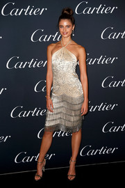 Taylor Hill flaunted her supermodel figure in a clingy Ralph Lauren halter dress with a fringed skirt at the Cartier Juste Un Clou event.