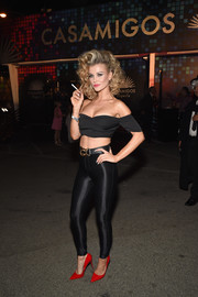 Joanna Krupa nailed Olivia Newton-John's look from 'Grease' with this black skinnies and off-the-shoulder top combo.
