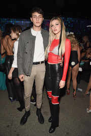 Nicola Peltz sealed off her look with a pair of black and red leather pants.