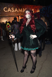 Michelle Trachtenberg paired a green wrap dress with some creepy face paint for the Casamigos Halloween party.
