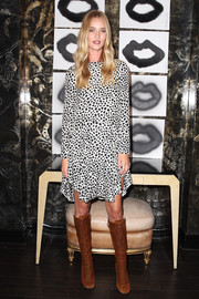 Rosie Huntington-Whiteley added major edge with a pair of knee-high brown lace-up boots by Miu Miu.
