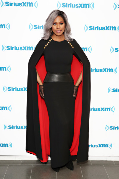 Laverne Cox was goth-glam in a caped black and red gown by Escada while visiting SiriusXM.