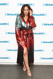 Dascha Polanco looked tres cool in an ombre trenchcoat by Victoria Hayes while visiting SiriusXM.