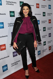 Shohreh Aghdashloo paired a black leather-panel zip-up jacket with a fuchsia ruffle blouse for the Artios Awards.