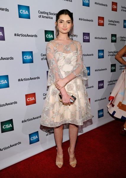 Emily Robinson was demure and elegant at the Artios Awards in a floral-embroidered sheer-overlay dress.