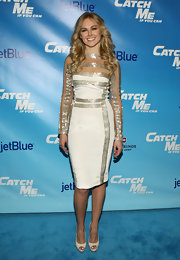 Laura Bell Bundy stood out on the red carpet in a white cocktail dress with silver panels at the 'Catch Me if You Can' Broadway opening.