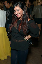Angelina Pivarnick's sheer black ruffle blouse was an alluring complement to her blue jeans at the Catch Roof anniversary party.
