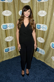 Hannah Simone went for casual sophistication in a sleeveless black crossover jumpsuit at the Catdance Film Festival.