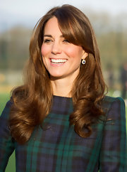 The Duchess sported some fabulous side-swept bangs (with, of course, her signature curls!) during a visit to her former grade school.
