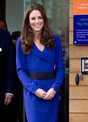 Kate Middleton belted her coat dress with this black elastic number for her visit to the Treehouse Children's Centre.