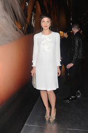 Maggie Gyllenhaal rocked a simple white frock with a ruffle detail at the Prada Gatsby cocktail party.