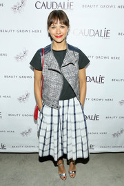 Rashida Jones went for an edgy vibe in a moto-chic vest layered over a black shirt during the Caudalie Boutique Spa grand opening.