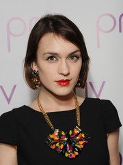 Ella Catliff punched up her simple black outfit with a chunky and colorful statement necklace by MAIOCCI.