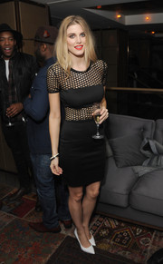 Ashley James was edgy-sexy at the PRIV launch in a tight-fitting LBD with a mesh yoke and midsection.