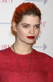 Pixie Geldof amped up her look. She slathered her lips with ravishing red lipstick.