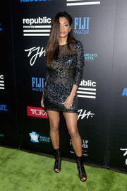 Nicole Scherzinger flashed plenty of skin in a partially sheer, beaded mini dress at the Celebration of Music with Republic Records event.