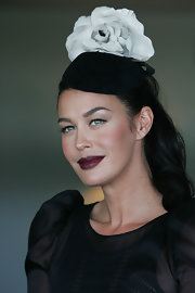 Megan Gale topped off her Australian Derby Day attire with a sweet black-and-white floral hat.