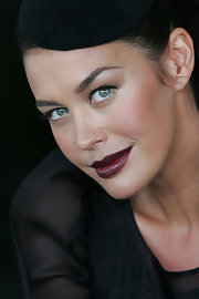 Megan Gale achieved a dramatic beauty look with a swipe of dark red lipstick during Australian Derby Day.