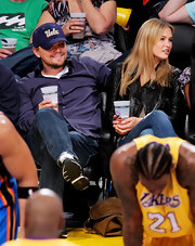 Leonardo DiCaprio watched the Lakers game wearing a purple button-down, jeans, and sneakers.