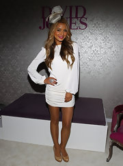 Havana Brown showed off her sexy legs at the BMW Cup Day in her white mini dress.