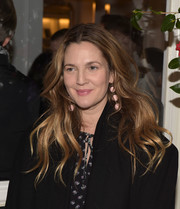 Drew Barrymore attended the Club Monaco presentation wearing her hair in messy-chic boho waves.