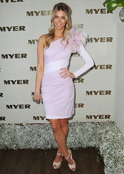 Jennifer Hawkins wore a playful mono-sleeve pale pink dress with a frothy feathered shoulder for Crown Oaks Day.