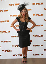 Laura Dundovic looked sexy and feminine during Derby Day in a black leather peplum dress.