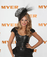 For Derby Day, Laura Dundovic chose a black mesh decorative hat with spiked detailing.