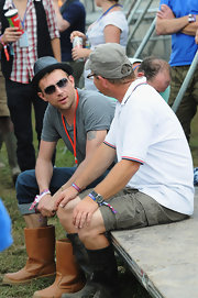 Damon showed off a classic fedora hat in a cool grey shade while hitting attending the Glastonbury festival.