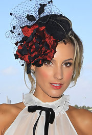 Laura Dundovic opted for a lovely red and black floral fascinator during Golden Slipper Day.