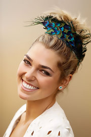 Ashley Hart held her hair up using a peacock printed headband.