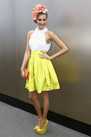 Laura Dundovic attended Melbourne Cup Day teetering on sky-high peep-toe wedges that matched the color of her skirt.