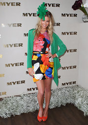 Jennifer Hawkins got playful on Melbourne Cup Day with a green fascinator and colorful frock.