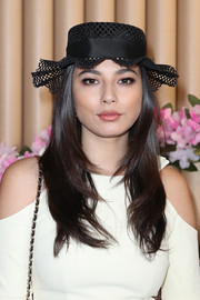 Jessica Gomes topped off her look with a decorative straw hat.