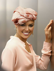 Ashley Hart chose gold dangle earrings to match her Melbourne Cup look.