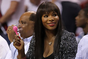 Serena Williams wore a long and super-straight hair look with choppy brow-grazing bangs at a Miami Heat vs. Dallas Mavericks game.