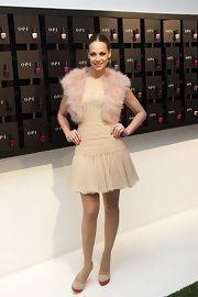 Eva Gonzales attended the OPI Nails Products event wearing a pleated short dress.