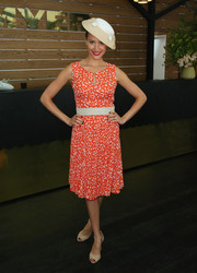 Rachael Finch kept things bright in an orange print dress during Oaks Day.