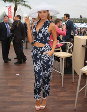 Jesinta Campbell looked fun and sexy during Oaks Day in a floral jumpsuit with a belly-baring cutout.