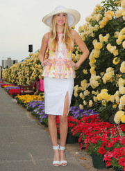 Whitney Port paired her chic top with a sexy white pencil skirt featuring a thigh-baring slit.