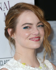 Emma Stone went for a whimsical beauty look with bright blue eyeshadow during the premiere of 'Irrational Man.'