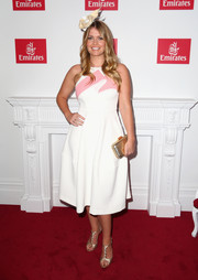 Kitty Spencer completed her shining accessories with a gold clutch.